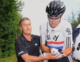 Dr. Richard Freeman with Bradley Wiggins after a crash at the 2011 Tour de France