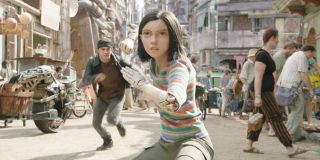 Alita: Battle Angel Alita stands in fighting stance, with Hugo running up from behind