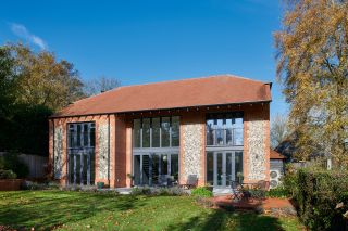 a self build home with a stone clad exterior