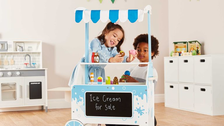 Aldi wooden toys: ice cream stand being played with by two children
