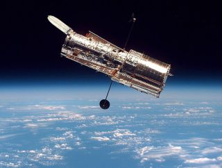 The Hubble Space Telescope, shown here above the Earth, is one mission that was recommeded by the National Academy of Sciences' decadal survey.