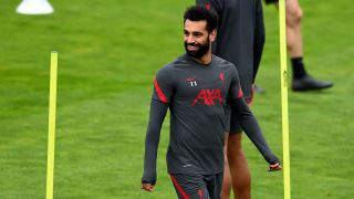 Mohamed Salah of Liverpool is all smiles during a training session at Melwood Training Ground on September 10.