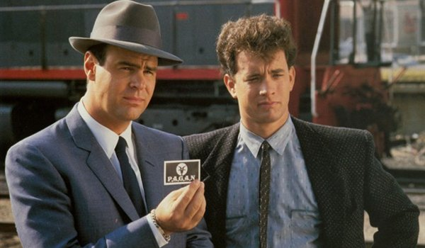 Dragnet Dan Aykroyd and Tom Hanks present evidence to a suspect