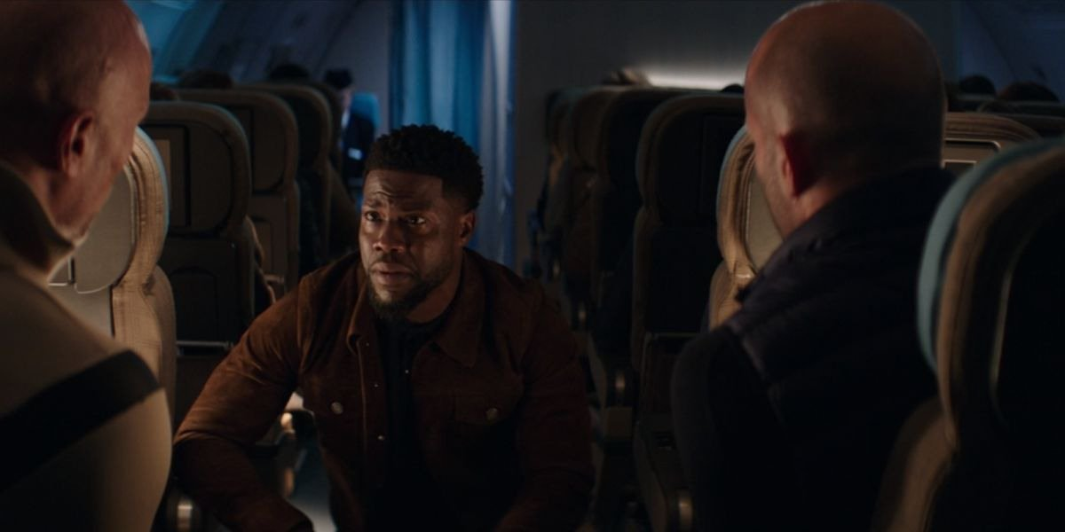 Hobbs and Shaw Kevin Hart crouched on a plane