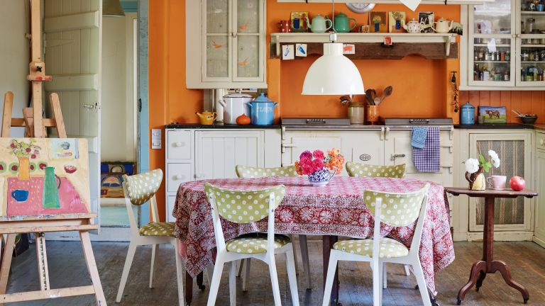 orange kitchen walls in converted cow byre home