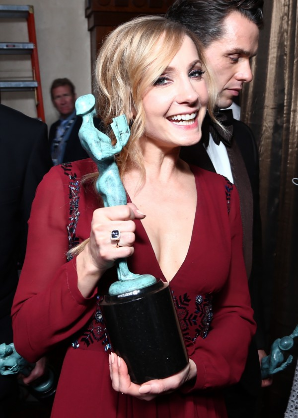 Downton Abbey's Joanne Froggatt with the trophy the cast won (John Salangsang/AP)