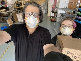Limor Fried and Phillip Torrone in protective masks