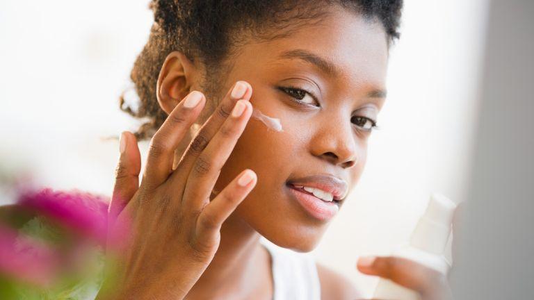 travel-sized sunscreen - Woman putting on sunscreen