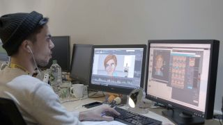 Man modelling 3D characters on computer