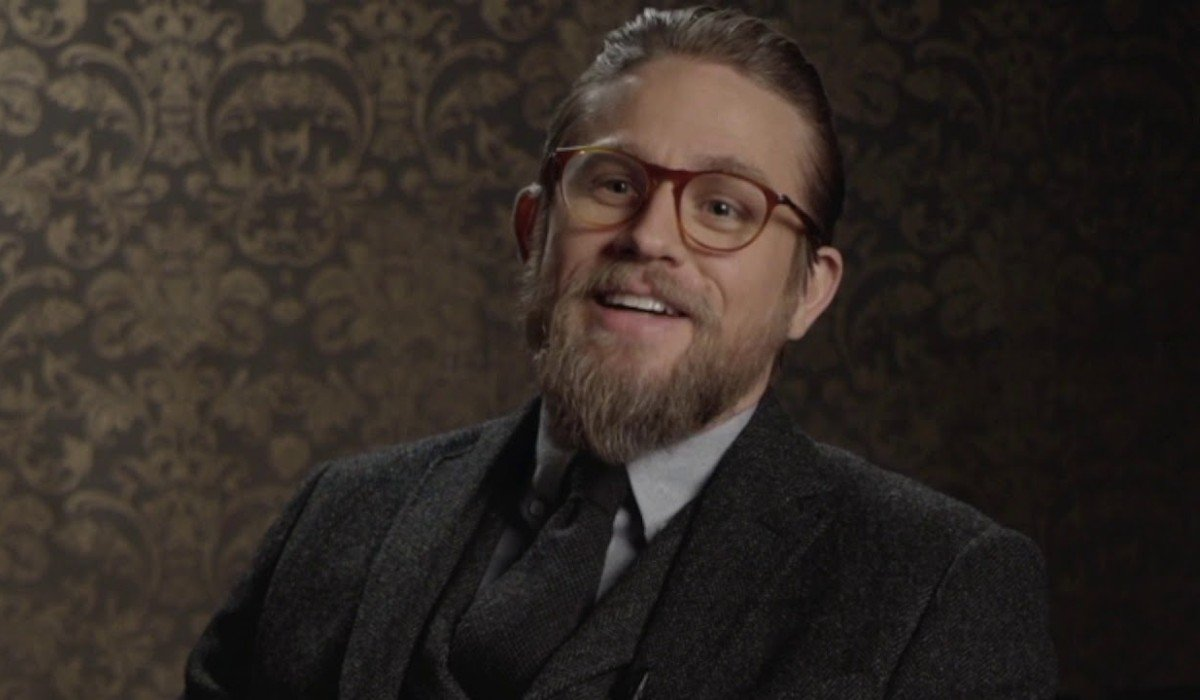 The Gentlemen Charlie Hunnam talking on camera in his suit