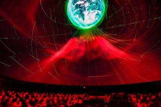 The American Museum on Natural History debuted the Hayden Planetarium's latest space show, Worlds Beyond Earth, the first media presentation designed to take full advantage of the intense dynamic range enabled by the planetarium's new Christie Eclipse RGB laser projection system.
