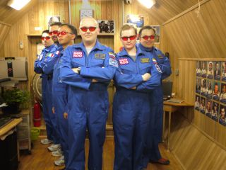 The Mars500 crew poses for a fun portrait with red protective goggles.