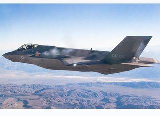 A F-35 fires its gun.
