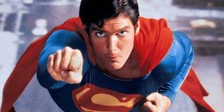 Superman flies toward you.