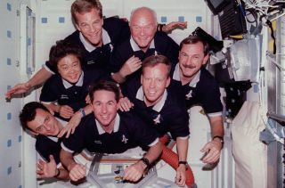 John Glenn and STS-95 Crewmates in Flight