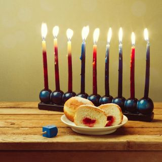 hanukkah menorah with jelly doughnuts