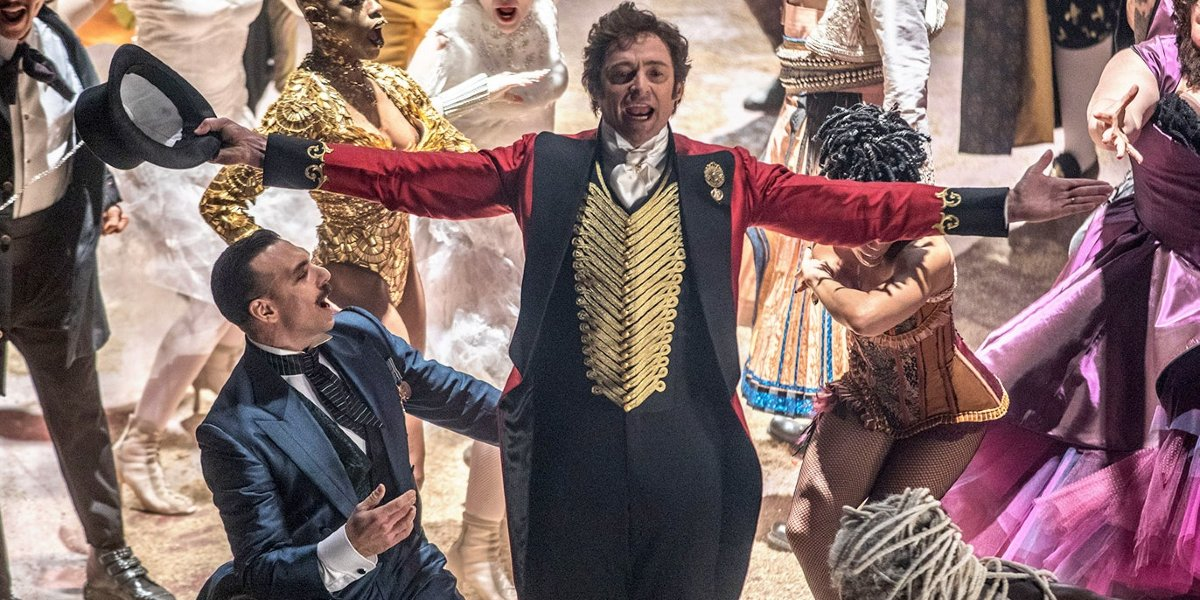 Hugh Jackman sings in the middle of the circus in The Greatest Showman.