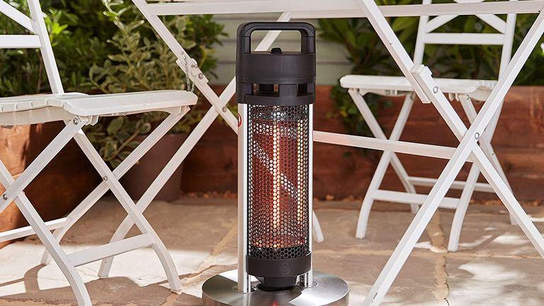 Swan Al Fresco SH16330N Portable Patio Heater in back garden under white bistro set