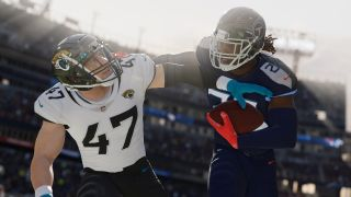 two madden players wrestling for the ball