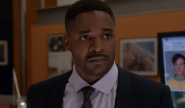 NCIS Clayton Reeves looks sad at the office