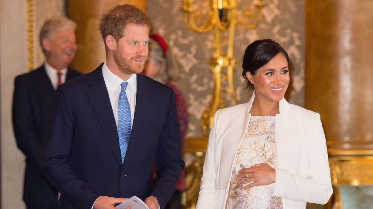 Meghan, Duchess of Sussex and Prince Harry, Duke of Sussex attend a reception to mark the fiftieth anniversary of the investiture of the Prince of Wales at Buckingham Palace on March 5, 2019 in London, England