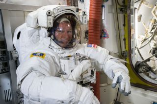 NASA astronaut Terry Virts tries on his spacesuit in preparation for a Feb. 21 spacewalk outside the International Space Station with crewmate Barry Wilmore.