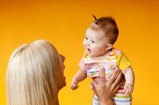 Baby mimicking mom