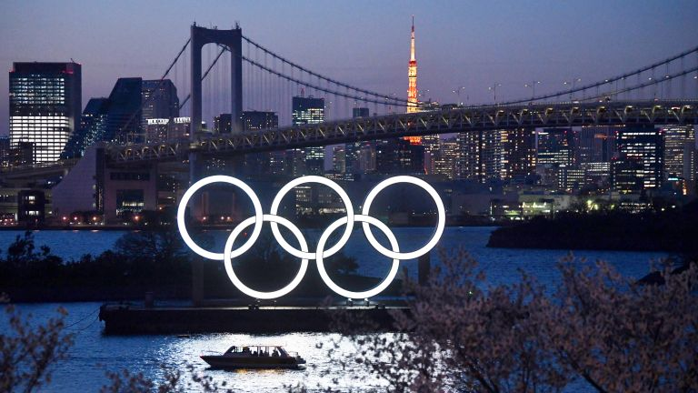 A boat sails past the Tokyo 2020 Olympic Rings on March 25, 2020 in Tokyo, Japan.