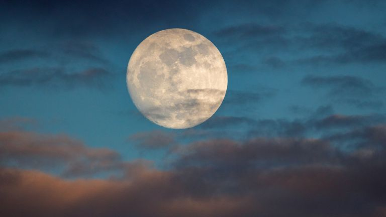 Full Moon, Buck Moon; This is a photo of a moon at over 98% full. The image was taken one day prior to the supermoon, or a moon that appears larger due to being the closest to earth in its elliptic orbit.