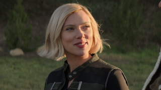 Black Widow smiling at the end of her movie