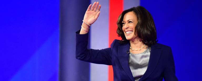 Democratic presidential hopeful California Senator Kamala Harris waves as she arrives onstage for the third Democratic primary debate of the 2020 presidential campaign season