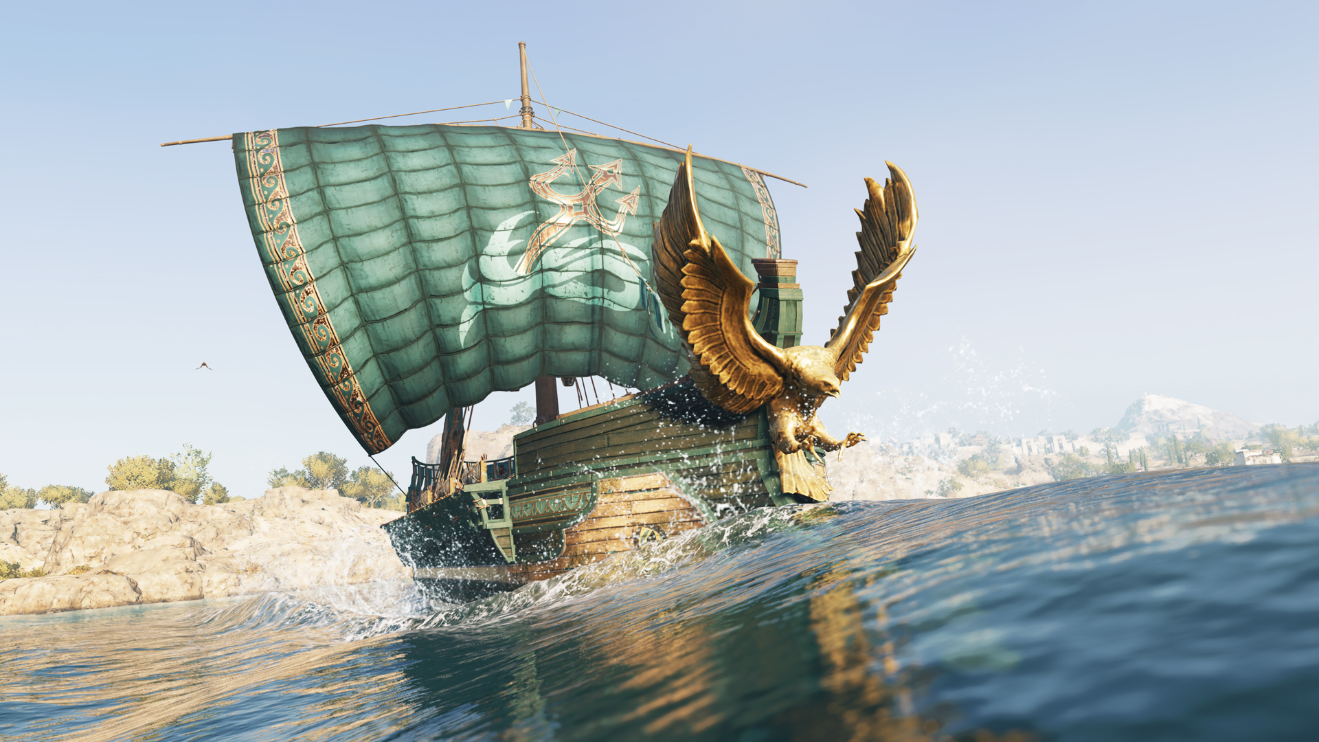 Boat with sail up and gold eagle mounted on the prow