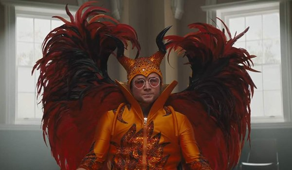 Rocketman Elton sits in group therapy in his devil costume