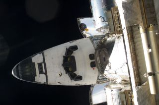 Astronauts Perform Spacewalk Finale Outside Shuttle Atlantis