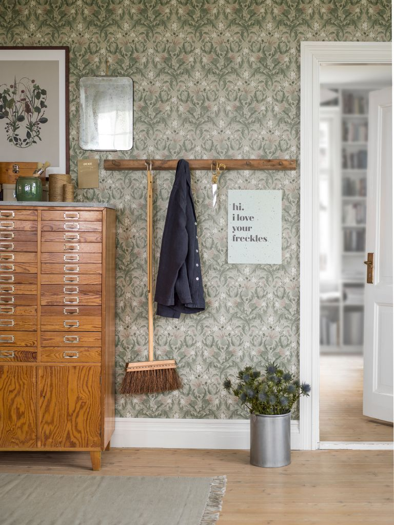Hallway storage: floral wallpaper in hallway with coat rack and drawers