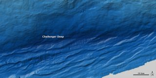 This image of the Challenger Deep in the Mariana Trench, the deepest spot on Earth, was made using sound waves counched off the sea floor. Darker blues represent deeper spots.