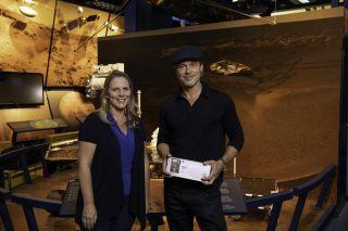 Actor Brad Pitt (right) shows his Mars