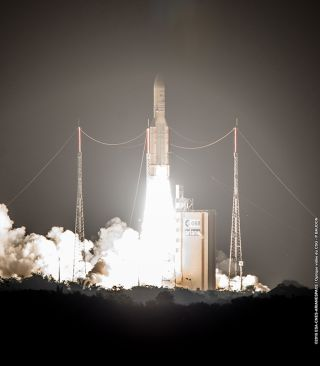 An Arianespace Ariane 5 rocket launches the Arabsat-6B (BADR-7) and GSAT-15 satellites from the Guiana Space Center in Kourou, French Guiana on Nov. 10, 2015.