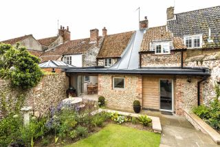 Renovated cottage with twisting roof