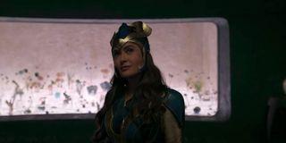 Salma Hayek looks up smiling, in full costume in Marvel's Eternals.