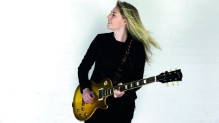 Portrait of Joanne Shaw Taylor wearing a Gibson Les Paul guitar