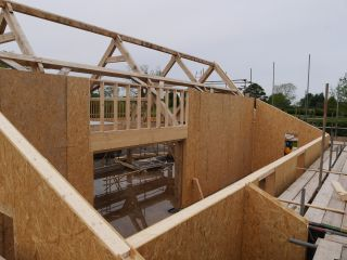 a structural insulated panel build in process