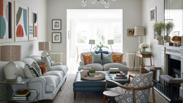 Neutral living room with color and pattern in Victorian house in London