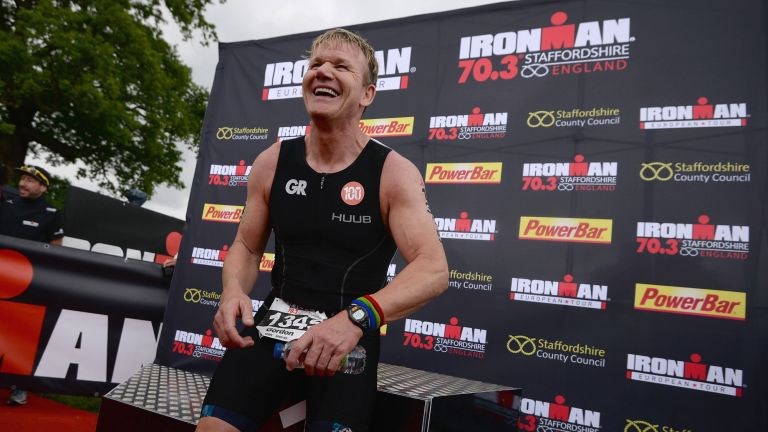Gordon Ramsay smiles after completing an Ironman competition