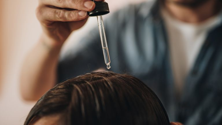 hair oil pipette above hair