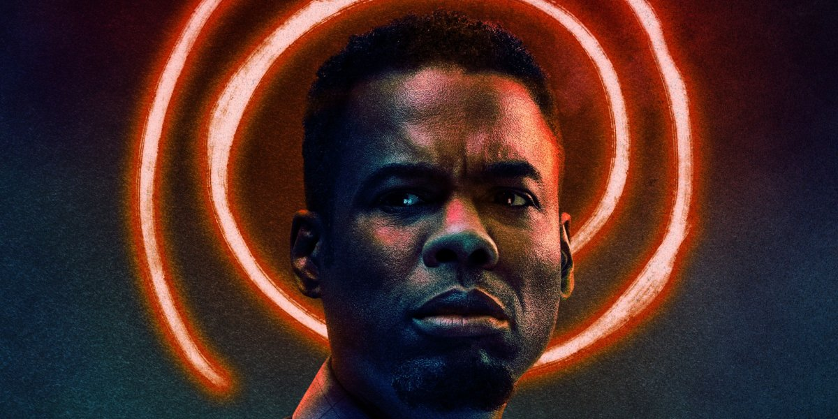 Chris Rock stands in front of a spiral halo in Spiral: From the Book of Saw's poster.