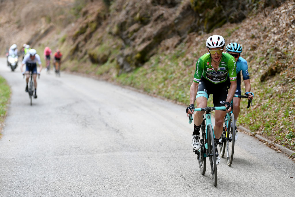 PIEVEDIBONO ITALY APRIL 22 Simon Yates of United Kingdom and Team BikeExchange green leader jersey Aleksander Vlasov of Russia and Team Astana Premier Tech Daniel Martin of Ireland and Team Israel StartUp Nation attack on breakaway during the 44th Tour of the Alps 2021 Stage 4 a 1686 to stage from Naturns to Valle del Chiese Pieve di Bono TourofTheAlps TouroftheAlps on April 22 2021 in Pieve di Bono Italy Photo by Tim de WaeleGetty Images
