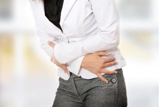 woman leaning over with a stomachache.