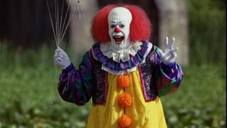 Stephen King's IT 1990 Pennywise The Dancing Clown Tim Curry holding Balloons