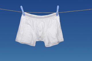 Men's underwear hanging from a clothesline.